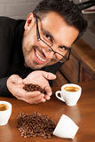 Coffee adiction. Coffee sommelier happy with hes roasting recipe Royalty Free Stock Photo