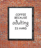 Coffee because adulting is hard written in picture frame. Close stock images