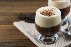 Coffee affogato with vanilla ice cream and espresso. Glass with coffee drink and icecream. Wooden table texture chocolate cold dessert flavor mocha sweet cafe royalty free stock photos