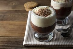 Coffee affogato with vanilla ice cream and espresso. Glass with coffee drink and icecream. Wooden table texture chocolate cold dessert flavor mocha sweet cafe stock images