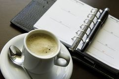 Coffee and Agenda. A close-up of a cup of coffee and agenda Stock Photography