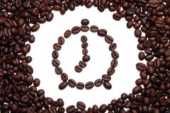Coffee alarm clock made of coffee beans Royalty Free Stock Photo