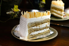 Coffee almond butter cake and cream in coffee shop Royalty Free Stock Photography