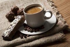 Coffee and almond cake. On sacking Stock Image
