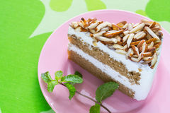 Coffee almond cake delicious with green mint  on dish. Stock Image