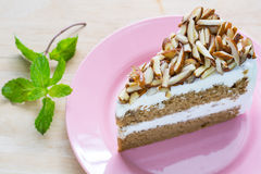 Coffee almond cake delicious with green mint  on dish Royalty Free Stock Images