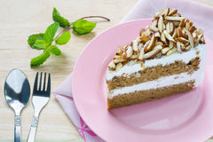 Coffee almond cake delicious with green mint  on dish . Stock Photo