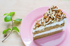 Coffee almond cake delicious with green mint . Stock Photos