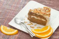 Coffee almond cake with orange slice Royalty Free Stock Photo