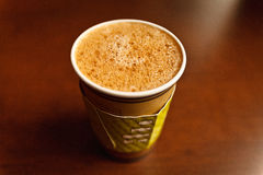 Coffee americano in paper takeout cup. Stock Photos