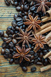Coffee anise and cinnamon. On wooden table Royalty Free Stock Images