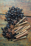 Coffee anise and cinnamon. On wooden table Royalty Free Stock Image