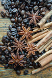 Coffee anise and cinnamon. On wooden table Royalty Free Stock Photos