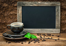 Coffee, antique blackboard, coffee leaves and beans. retro style Stock Images
