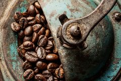 Coffee antique grinder. Coffee antique blue grinder with coffee beans royalty free stock image