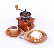 Coffee and apple-pie. Coffee-grinder, coffee and apple-pie on white background Royalty Free Stock Images
