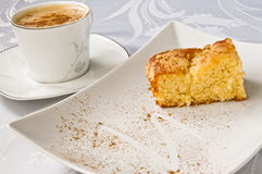 Coffee and apple pie. A cup of latte with cinnamon and an apple pie Royalty Free Stock Images