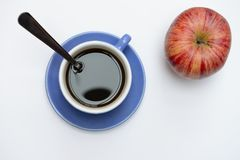 Coffee and apple. On white background royalty free stock images