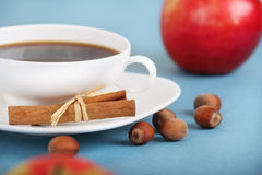 Coffee and apples on the blue background Royalty Free Stock Photo