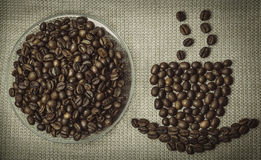Coffee aroma concept. Coffee cup made from beans. Stock Photos