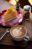 Coffee aroma latte art cup and tasty christmas cake on wood table relaxtime in cafe coffee shop royalty free stock image