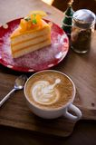 Coffee aroma latte art cup and tasty christmas cake on wood table relaxtime in cafe coffee shop stock photos