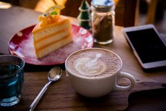 Coffee aroma latte art cup and tasty christmas cake on wood table relaxtime in cafe coffee shop stock image