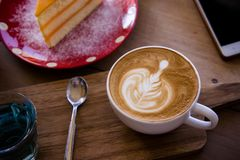 Coffee aroma latte art cup and tasty christmas cake on wood table relaxtime in cafe coffee shop royalty free stock photo