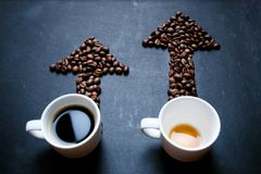 Coffee and arrow from coffee beans. Move up of energy. Trend up of energy. Arrow and graph. Coffee on a blackboard. Concept of ene royalty free stock photos