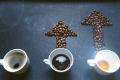 Coffee and arrow from coffee beans. Move up of energy. Trend up of energy. Arrow and graph. Coffee on a blackboard. Concept of ene stock photography