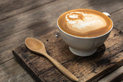 Coffee art on wooden table. With spoon Stock Photos