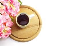 Coffee and artificial pink flowers on white background. Still life with coffee and artificial pink flowers royalty free stock photos
