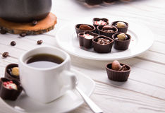 Coffee with assortment of chocolate candies royalty free stock photos