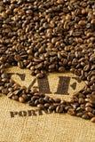 Coffee beans on hessian sack Stock Photos