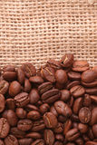 Coffee background. Coffee grains on canvas background stock photography