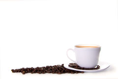 Coffee background. Cup of coffee with coffee beans isolated on white Stock Images