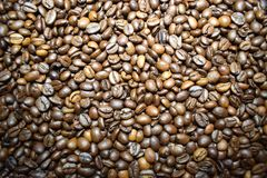 Coffee background coffee beans. Coffee background cheerfulness morning espresso cappuccino mood caffeine coffee beans brown texture deliciously many grains Royalty Free Stock Photo