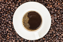 Coffee background with beans and white cup. copy space. Royalty Free Stock Photos