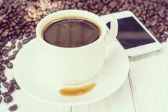 Coffee background with beans and white cup. copy space. Stock Photography