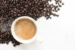 Coffee background with beans and white cup. copy space. Royalty Free Stock Images