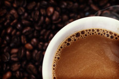 Coffee background with beans and white cup. copy space. Royalty Free Stock Image