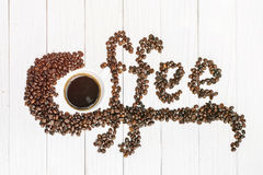 Coffee background with beans and white cup. copy space. Royalty Free Stock Photo