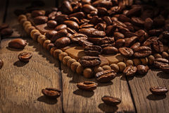 Coffee background with beans on wooden board dark atmosphere Stock Images