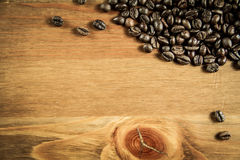 Coffee background. Coffee beans on a wooden table Royalty Free Stock Photos
