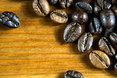 Coffee background. Coffee beans on a wooden table Stock Photography