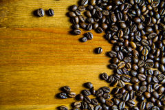 Coffee background. Coffee beans on a wooden table Royalty Free Stock Photography