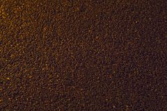 Coffee background. Brown background, from coarsely ground coffee beans Stock Image