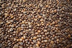 Coffee background coffee beans. Coffee background cheerfulness morning espresso cappuccino mood caffeine coffee beans brown texture deliciously many grains Stock Images