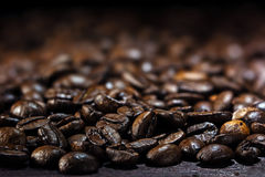 Coffee background, closeup of dark brown roasted coffee beans, c Royalty Free Stock Photos
