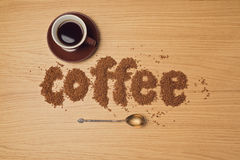 Coffee background with coffee cup and instant coffee letters. Royalty Free Stock Images
